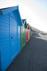 Row of brightly coloured beach huts