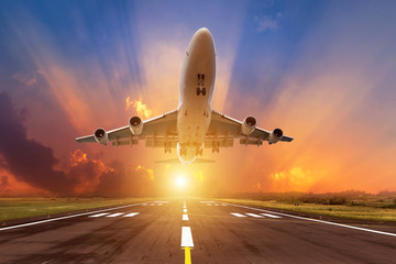 airplane flying take off from runway on sunset  Wall mural