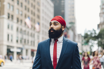 Businessman at street in Manhattan, New York, USA
