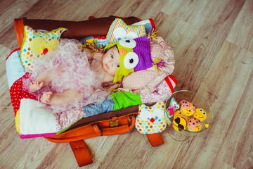 funny little girl lying in the bag
