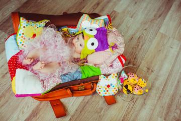 beautiful cheerful girl lying in the bag