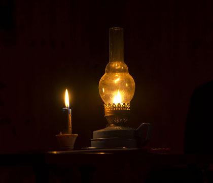 kerosene lamp and candles flicker in the dark warm