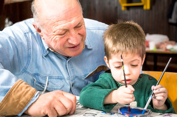 Grandson and grandfather painting
