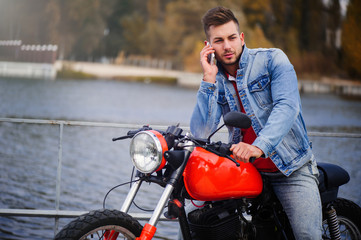 trendy guy on a motorcycle talking on the phone