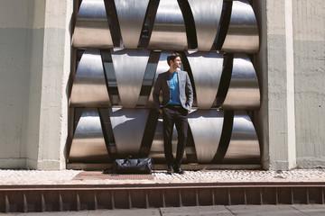Elegant man in suit against of modern construction