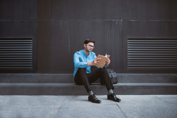 Man reading outside.