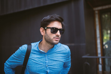 Handsome man in sunglasses looking away
