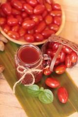 Tomato juice and pear cherry tomatoes.