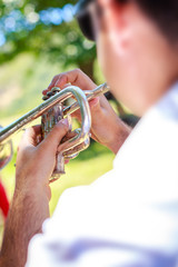 Close up trumpeter blowing the trumpet at outdoor