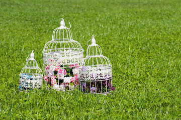 Vintage decorative birdcage with artificial flowers. Beautiful wedding/birthday/romantic decor. Shabby chic birdcages with flowers.