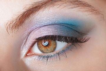 Woman with blue eye smokey beauty make up