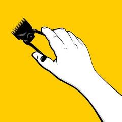 Barber hand holding vintage hair clipper