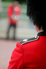 Fotobehang Rood, zwart, wit Abstract guardsman trooping the colour London England