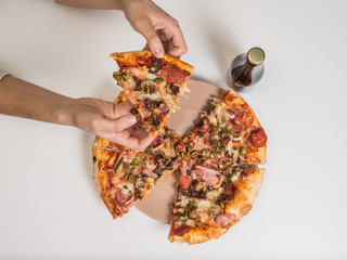 pizza on the table with girls hand