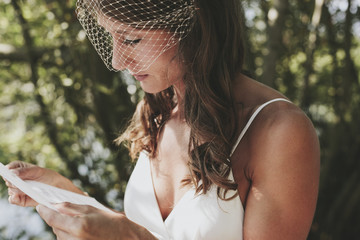 A bride reading from a piece of paper;Kirkland washington united states of america