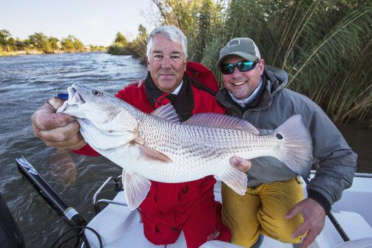Man holding a redfish (sciaenops ocellatus);Venice louisiana united states of america