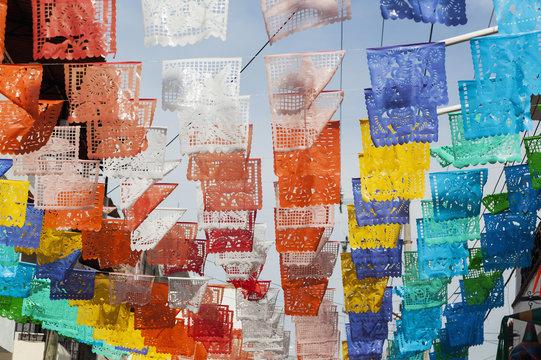 Colourful mexican fiesta flags decorate a street;Puerto vallarta mexico