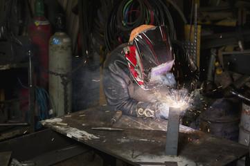 Female welder welding in a shop;Edmonton alberta canada