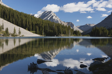 Mountain reflecting in lake with blue sky and clouds in kananaskis provincial park;Alberta canada