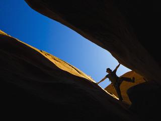 A male athlete exploring utah slot canyons;Hanksville utah united states of america
