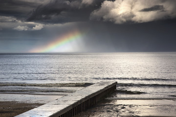 A rainbow shining in the storm clouds;Blyth northumberland england