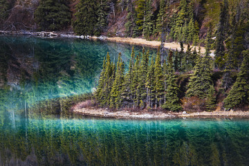 Glassy turquoise emerald lake;Carcross yukon canada