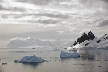 Icebergs and mountains along the coastline;Antarctica