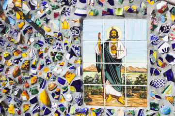 Jesus is depicted in a colour tile mosiac on a street;Puerto vallarta mexico