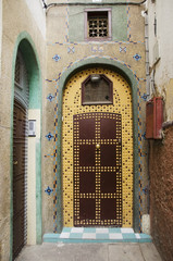 Uniquely decorated door with an arch and a design on the facade of the house;Casablanca morocco