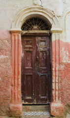 A weathered wooden door and doorframe with old painted walls;Casablanca morocco