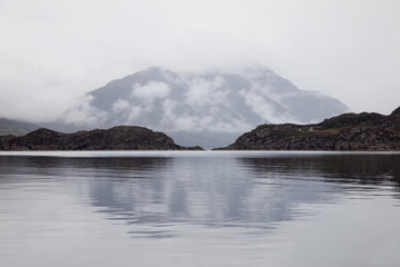 Low cloud covers a mountain along the coastline;Shieldaig wester ross scotland