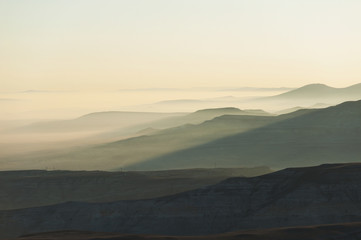 Silhouette of curves in the landscape in the fog;Goreme nevsehir turkey