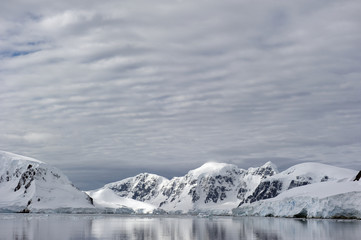 Mountains reflected in the water;Antarctica