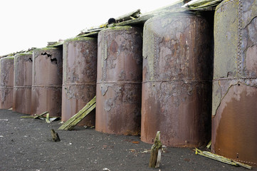 Large metal storage containers in a row;Whalers bay antarctica