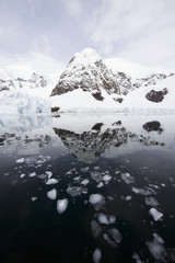 Mountains and glaciers reflected in the water;Antarctica