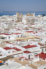 Whitewashed buildings in a town on the coast;Cadiz andalusia spain