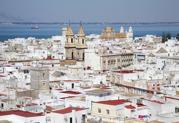 Whitewashed buildings in a town along the coast;Cadiz andalusia spain