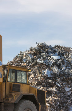 A truck in front of a large pile of garbage;South shields tyne and wear england