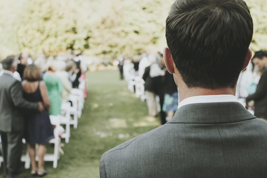 Rear view of man at outdoor wedding ceremony