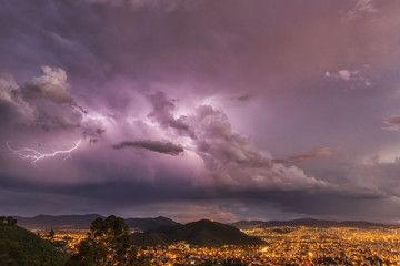 Lightning in the night skies above the city of Cochabamba; Cochabamba, Bolivia