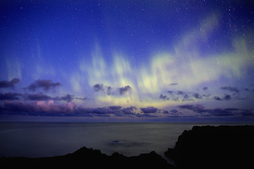 Scenic view of ocean with northern lights
