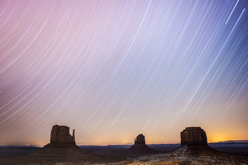 Two-hour star trails capture with The Mittens at Monument Valley Navajo Tribal Park; Arizona, United States of America
