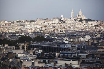 Cityscape of Paris and buildings against a blue sky; Paris, France