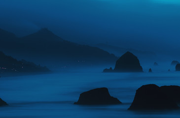 Dawn reveals the coastline; Cannon Beach, Oregon, United States of America