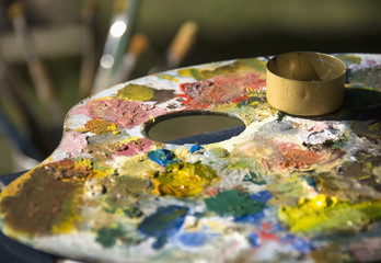 An Artist's Palette Filled With Paint