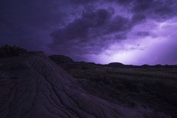 Lightning illuminates the skies as a storm front moves over Dinosaur Provincial Park; Alberta, Canada