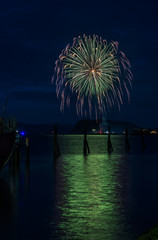 Fireworks explode on the fourth of July; Astoria, Oregon, United States of America