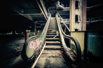 Dramatic view of damaged escalators in abandoned building. Apocalyptic and evil concept Wall mural