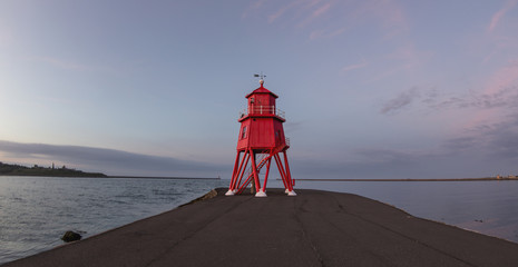 Red lighthouse along the coast at sunset; South Shields, Tyne and Wear, England