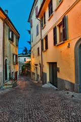 Narrow old street in Italy at night